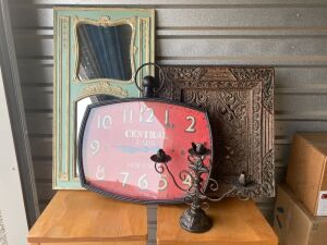 "Home decor including a mirror (20""x37""), battery operated wall clock (26""x27""), Kirkland's art (22""x25"") and a candelabra"