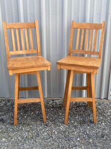 "2 solid maple handcrafted bar height chairs from Amish Kalona, IA - measure 4' H x 18.5"" L x 17.5"" W (30.5"" H seat). See chair mates in lot 299."