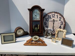 "6 clocks - untested - Linden mantle (27x12) quartz chime, Parliament (made in China) 31 day chime, Kensington Station bottle cap style sign (23"" and hands are loose), Howard Miller brass desk clock, picture frames"