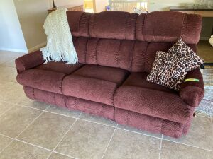"80"" La-Z-Boy double reclining sofa w/ throw pillows afghan"