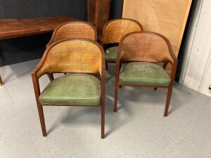 Four mid century modern Dunbar furniture chairs. Chairs have green cushions and match the table in Lot 10823. Some of the chairs have loose arms.