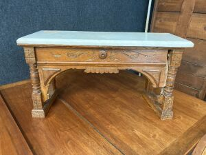 "Ornately carved marble topped piano bench measures 28""L x 11""W x 15""H. Bench is in need of repair."
