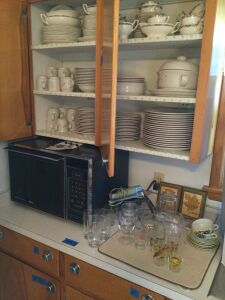 Set of unmarked 12 place setting china,  large set of stoneware dishes, an Amana Radar Range microwave and various drinking glasses
