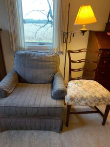 Overstuffed straight chair,  single straight dining chair and an early American style adjustable wrought iron electric floor lamp **See photos for damage to overstuffed chair)