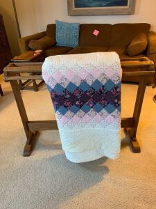 "96"" x 104"" quilt made by the Solon Ladies Church groups and a handmade walnut and oak quilt rack measures 36""L"