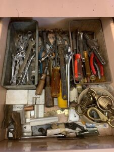 Two drawers of tools in previous cabinet includes breast drill, hand drill, bolt cutters, chisels, hammers, nippers, wrenches, screwdrivers and more