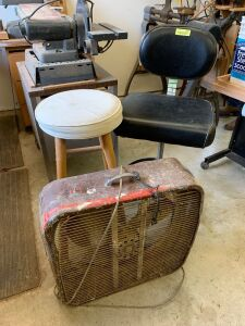 Two shop stools and a box fan