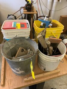 Four buckets of tools includes door hardware, trowels, paint brushes, caulk guns, caulk and boxes of nails all on a rolling stand