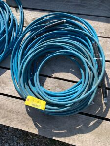 "Two non-marking pressure wash hoses 3/8""  Approximately 50', needs repair"