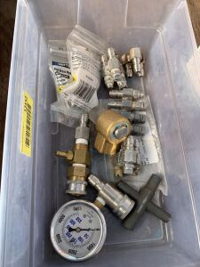 Assortment of nozzles swivel one snap coupler and a pressure gauge