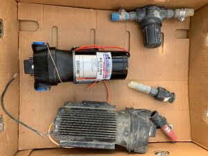 New FloJet 4.9 GPM pump and 1 used pump