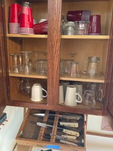 Kitchenwares includes-Tupperware, baking sheets, pizza stone, glassware, knives, dishes, storage containers