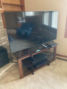"Samsung 55"" flatscreen TV w/ remote, Samsung BluRay player w/ remote and stand with glass shelves Stand measures 43 x 21 x 21"