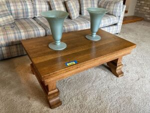 Vintage coffee table with hidden drawer and two vases Measures 42 x 26 x 16