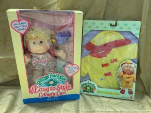 Cabbage Patch Kids Easy to Style Crimp'n Curl doll and a CPK rain slicker