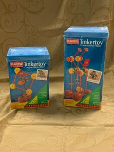Two Playskool Tinkertoy Construction Systems