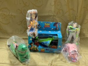 Toy Story RC Free Wheel Buggy and four stuffed characters from Burger King kids meals