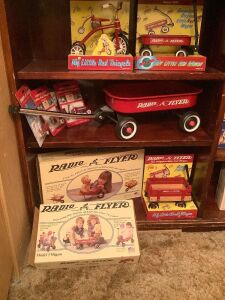 Radio Flyer items on left side of bookcase include wagons, miniatures