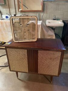 Vintage Silvertone radio phonograph (unknown condition) and a Toastmaster fan  Measures 33 x 16 x 28