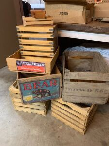 Approximately seven old and new wooden crates