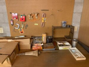Variety of items including lock sets, small shelf, bolts and screws, c-clamp, antenna wire and more