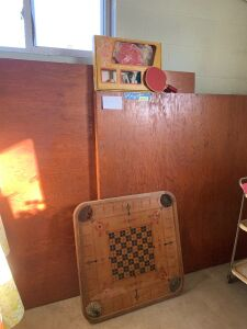 Two-piece ping pong table with accessories Each section is 54 x 60 and has pipe legs and a vintage carrom board