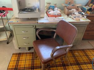 30x60 double pedestal steel desk with armchair, seed sacks and contents of drawers  **Items on top of desk not included, only items in drawers**