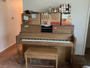 Player piano and approximately 150 rolls Piano measures 58 x 26 x 42
