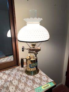 """Torch"" lamp with milk glass shade  There is a dent in the torch base"