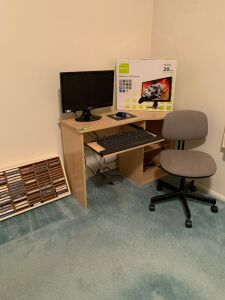 Computer desk with keyboard tray measures 42 x 20 x 28, adjustable height chair, Dell keyboard, Hannspree widescreen LCD monitor and cassette tapes