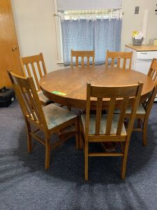"48"" round dining table on casters with six chairs and four 11"" leaves Another nice family sized dining table just in time for the holiday!"