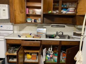 All in kitchen cupboards, stove drawer and on counter included  See description for items included