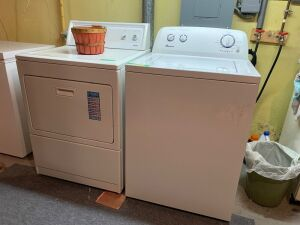 Kenmore elite electric dryer and an Amana washing machine Plus a basket of clothes pins in case you prefer to air dry!