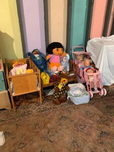 Cribs, a triplet stroller, dolls and bears and all the necessities to care for them