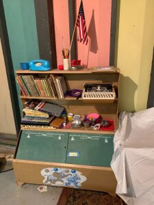 Childs work area and lots of things to keep them busy-books, typewriter, dishes, etc