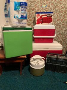 Coolers of various sizes, water thermos, GE 10 band radio, wooden step stool, Dirt Devil hand vac and paper towels