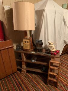 Three tier homemade shelf w bricks, table lamp, ship bookends, ladder shelf and more