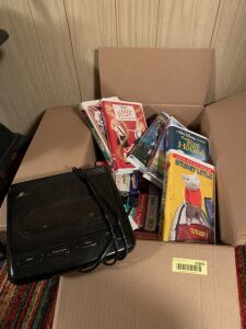 Variety of VHS tapes and VHS rewinder  Mostly kids tapes