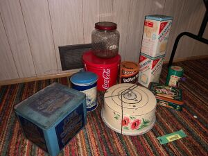 Approximately 10 various kitchen tins-one is Fine Fairy soda crackers, another is a tin cake carrier with wire bale handle, saltine cans, coffee jar and more