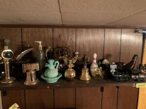 Large selection of classic Avon decanters and bottles