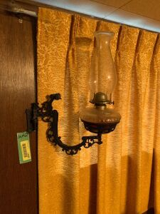 Two kerosene lamps with wall brackets and wall mount