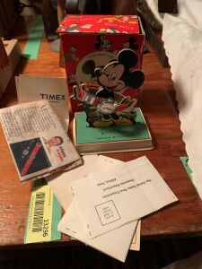 Mickey Mouse wrist watch on original display card Box is intact but in rough condition, the paperwork seems to be intact United States Time Corporation Waterbury Connecticut and a registration card from it