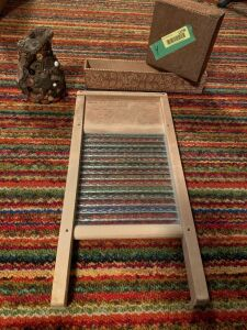 Small glass washboard, two embossed boxes and an antique memory jug