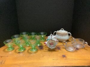 (9) green depression sherbets, tea bag holders, cream and sugar, sugar bowl  *One sherbet is chipped on the rim*