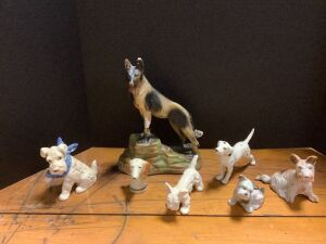 Seven dogs including a chalk ware German Shepherd (see photos for damage)