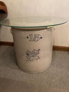 15 gallon Western Stoneware crock with lug handles and (2) 23 inch pieces of glass on top