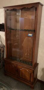 Locking 10 gun cabinet w sliding glass front and double door lower storage Measures 34 x 11 x 76
