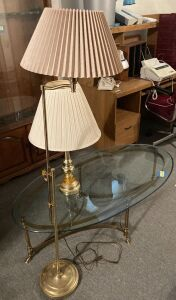 Oval brass tones coffee table measures 52 x 27, table lamp and 5 ft. single bulb lamp