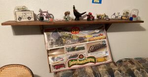Bachmann HO electric train set(unsure if complete), bikes, Bi-County Ambulance Ertl coin bank, Avon decanter and more
