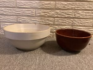 Two stoneware crock bowls-8 in. brown unmarked and 10 in. unmarked w chip on rim w crack